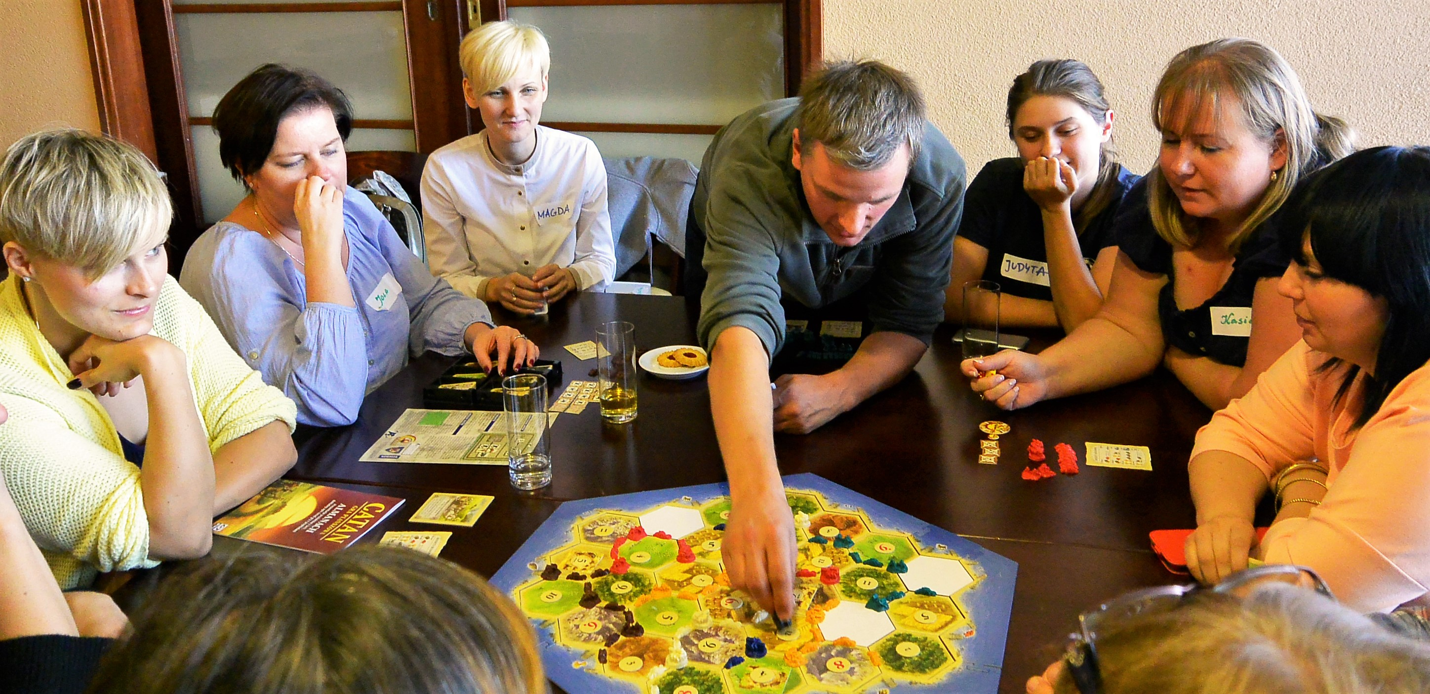 Teachers and librarians learned how to play Catan: Oil Springs through Green Games project.